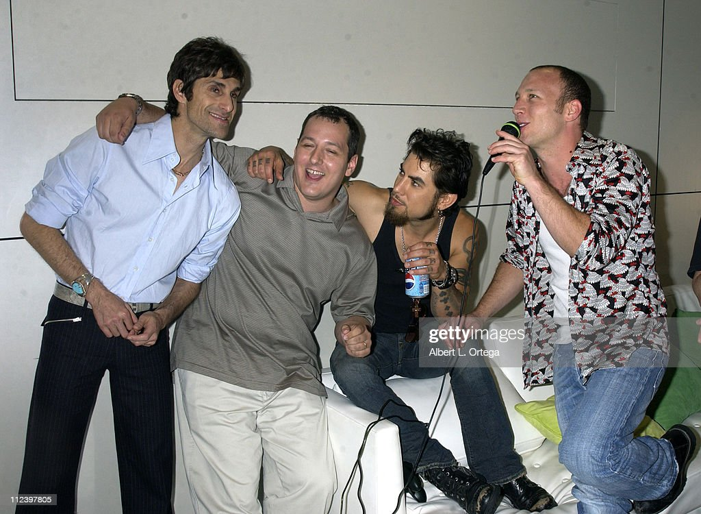 Perry Farrell, Dave Navarro and Stephen Perkins of Jane's Addiction with guest