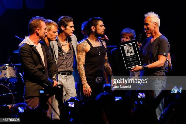 Perry Farrell Dave Navarro Steven Perkins and Chris Chaney of Janes Addiction receive The Elmer Valentine Award at House of Blues Sunset Strip on...