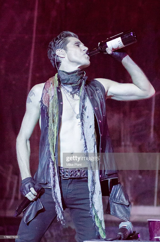 <a gi-track='captionPersonalityLinkClicked' href=/galleries/search?phrase=Perry+Farrell&family=editorial&specificpeople=213012 ng-click='$event.stopPropagation()'>Perry Farrell</a> of Jane's Addiction performs during the 2013 Rockstar Energy UPROAR Festival at Nikon at Jones Beach Theater on August 18, 2013 in Wantagh, New York.