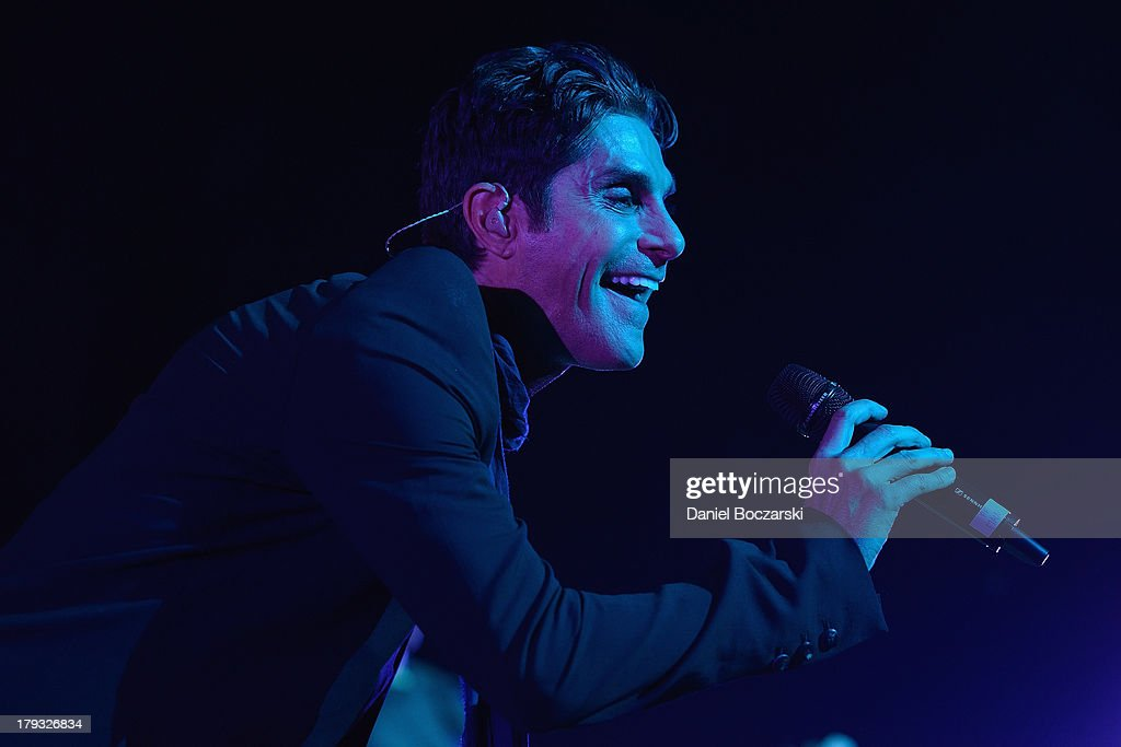 Perry Farrell of Jane's Addiction performs on stage at 2013 Rockstar Energy UPROAR Festival at First Midwest Bank Amphitheatre on August 22 2013 in...