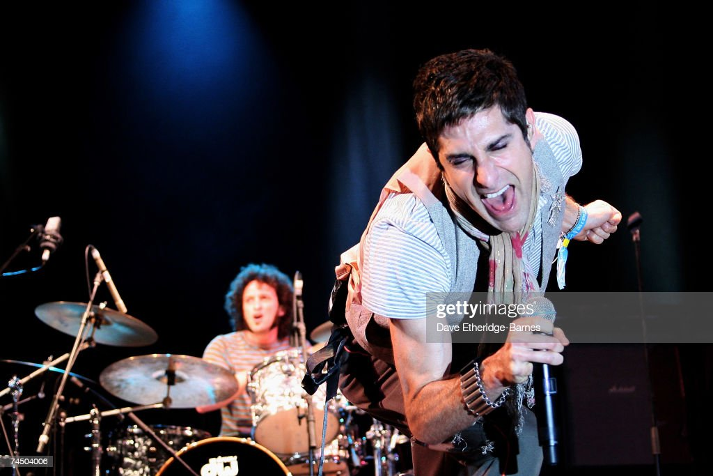 Perry Farrell of Satellite Party performs on the Dimebag Darrell Stage during day two of the Download Festival at Donington Park on June 9 2007 in...