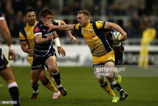 Perry Humphreys of Worcester Warriors is tackled by Alan MacGinty of Sale Sharks during the Aviva Premiership match between Sale Sharks and Worcester...