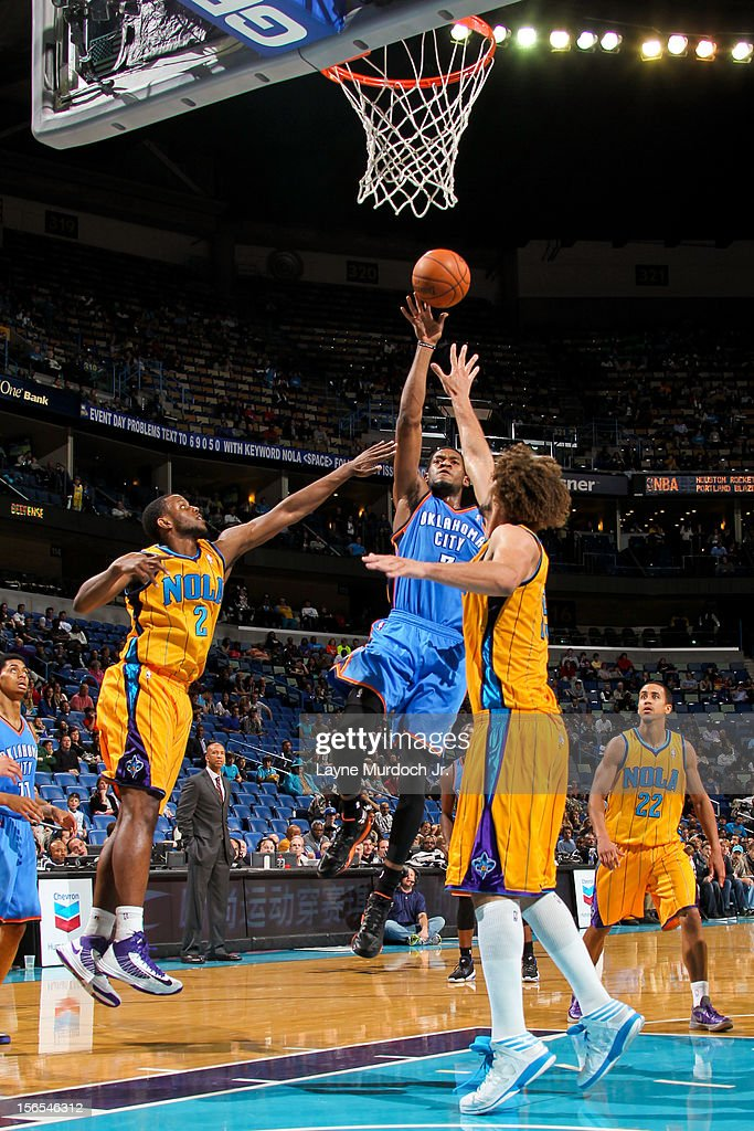 Perry Jones III #3 of the Oklahoma City Thunder shoots against <a gi-track='captionPersonalityLinkClicked' href=/galleries/search?phrase=Darius+Miller&family=editorial&specificpeople=5590631 ng-click='$event.stopPropagation()'>Darius Miller</a> #2 and <a gi-track='captionPersonalityLinkClicked' href=/galleries/search?phrase=Robin+Lopez&family=editorial&specificpeople=2351509 ng-click='$event.stopPropagation()'>Robin Lopez</a> #15 of the New Orleans Hornets on November 16, 2012 at the New Orleans Arena in New Orleans, Louisiana.