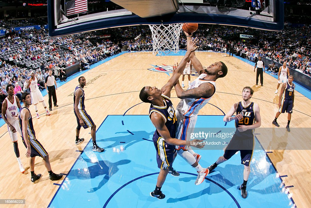 Perry Jones #3 of the Oklahoma City Thunder attempts a shot in the lane against <a gi-track='captionPersonalityLinkClicked' href=/galleries/search?phrase=Alec+Burks&family=editorial&specificpeople=6834208 ng-click='$event.stopPropagation()'>Alec Burks</a> #10 of the Utah Jazz on March 13, 2013 at the Chesapeake Energy Arena in Oklahoma City, Oklahoma.