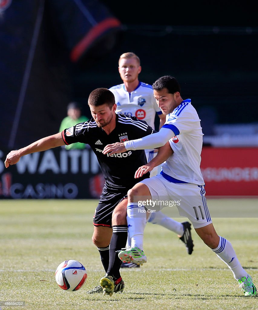 Perry Kitchen #23 of D.C. United and Dilly Duka #11 of Montreal Impact go after the ball during the first half at RFK Stadium on March 7, 2015 in Washington, DC.