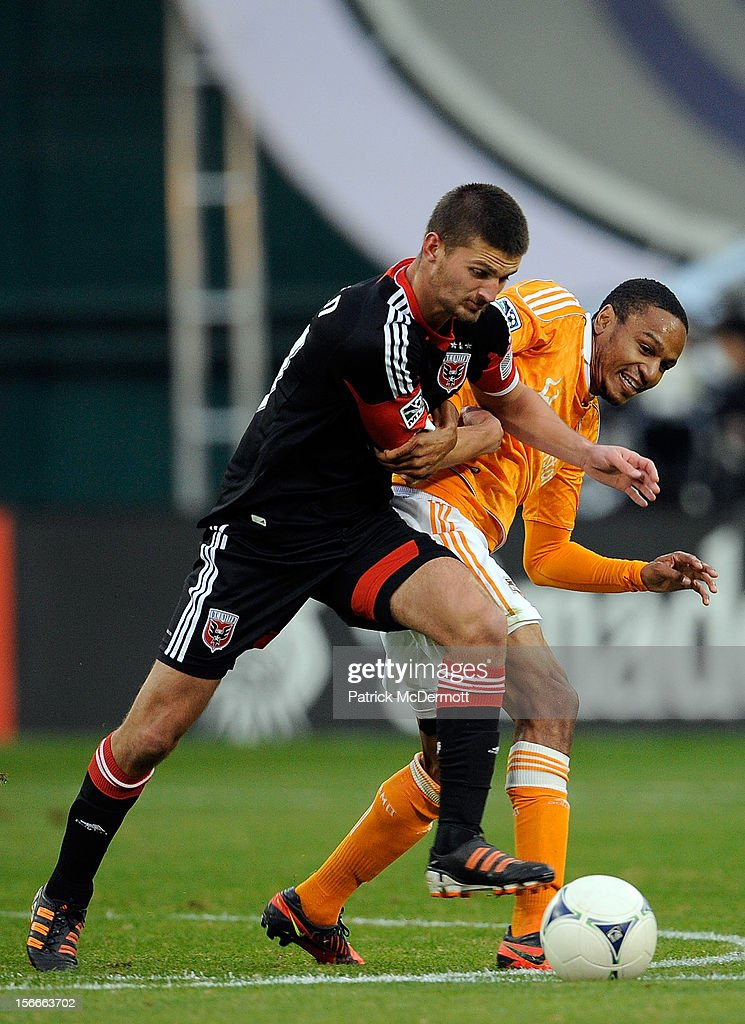 Perry Kitchen #23 of D.C. United battles for the ball against <a gi-track='captionPersonalityLinkClicked' href=/galleries/search?phrase=Ricardo+Clark&family=editorial&specificpeople=2196089 ng-click='$event.stopPropagation()'>Ricardo Clark</a> #13 of Houston Dynamo during leg 2 of the Eastern Conference Championship at RFK Stadium on November 18, 2012 in Washington, DC.