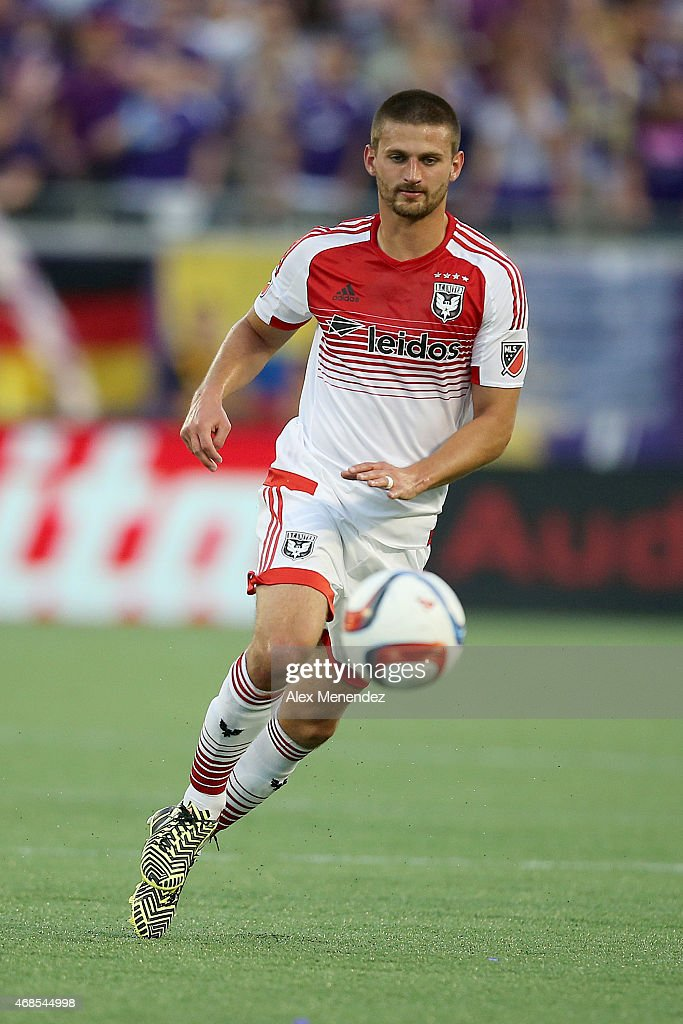 Perry Kitchen #23 of D.C. United dribbles the ball during a MLS soccer match between DC United and the Orlando City SC at the Orlando Citrus Bowl on April 3, 2015 in Orlando, Florida.