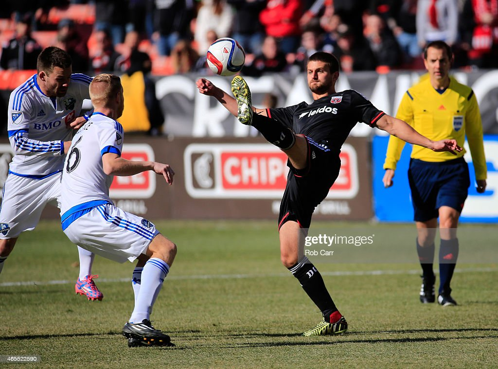 Perry Kitchen #23 of D.C. United passes the ball in front of Calum Mallace #16 of Montreal Impact during the first half at RFK Stadium on March 7, 2015 in Washington, DC.