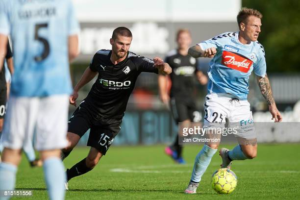 Perry Kitchen of Randers FC and Niki Zimling of SonderjyskE compete for the ball during the Danish Alka Superliga match between SonderjyskE and...