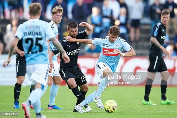 Perry Kitchen of Randers FC and Philip Zinckernagel of SonderjyskE compete for the ball during the Danish Alka Superliga match between SonderjyskE...