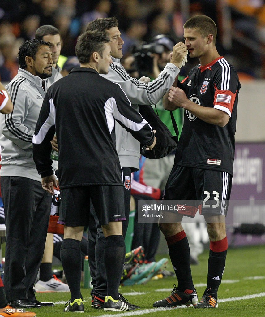 Perry Kitchen #23 of the D.C. United is treated for a bloody nose during first half action at BBVA Compass Stadium on March 2, 2013 in Houston, Texas.