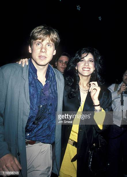 Perry Lang and Saundra Santiago during Premiere of 'Top Gun' After Party at America's in New York City NY United States