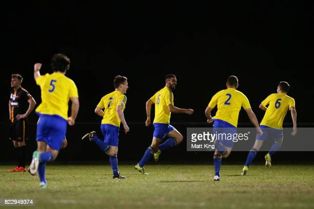 Perry Moustakas of the Bankstown Berries celebrates with team mates after scoring a goal during the FFA Cup round of 32 match between Bankstown...