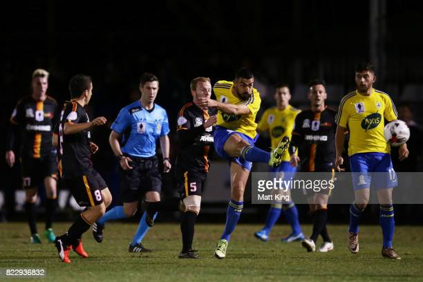 Perry Moustakas of the Bankstown Berries takes a shot on goal during the FFA Cup round of 32 match between Bankstown Berries and MetroStars SC at...