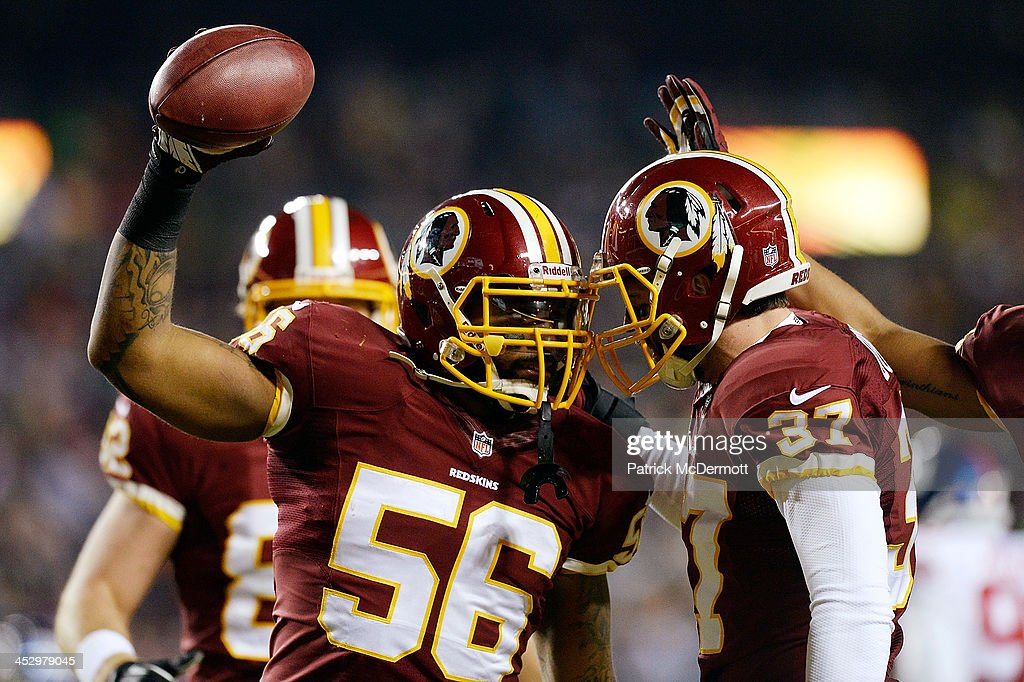 Perry Riley celebrates with Reed Doughty of the Washington Redskins after downing the ball on the New York Giants 1yard line on a 37yard punt by Sav...