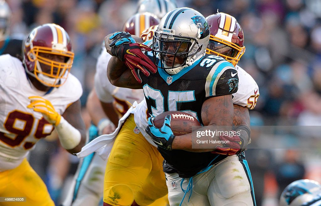 Perry Riley of the Washington Redskins wraps up Mike Tolbert of the Carolina Panthers during their game at Bank of America Stadium on November 22...