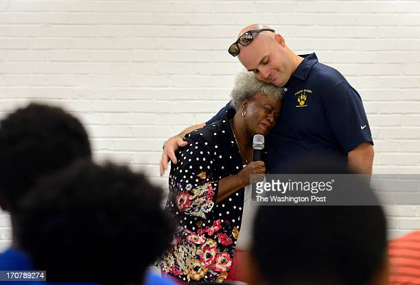Perry Street Prep rugby coach Tal Bayer receives a hug from Mary Komongnan the mother of 2004 Hyde School graduate PJ Komongnan during a goodbye...