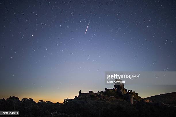 Perseid Meteor flashes across the night sky above Corfe Castle on August 12 2016 in Corfe Castle United Kingdom The Perseids meteor shower occurs...