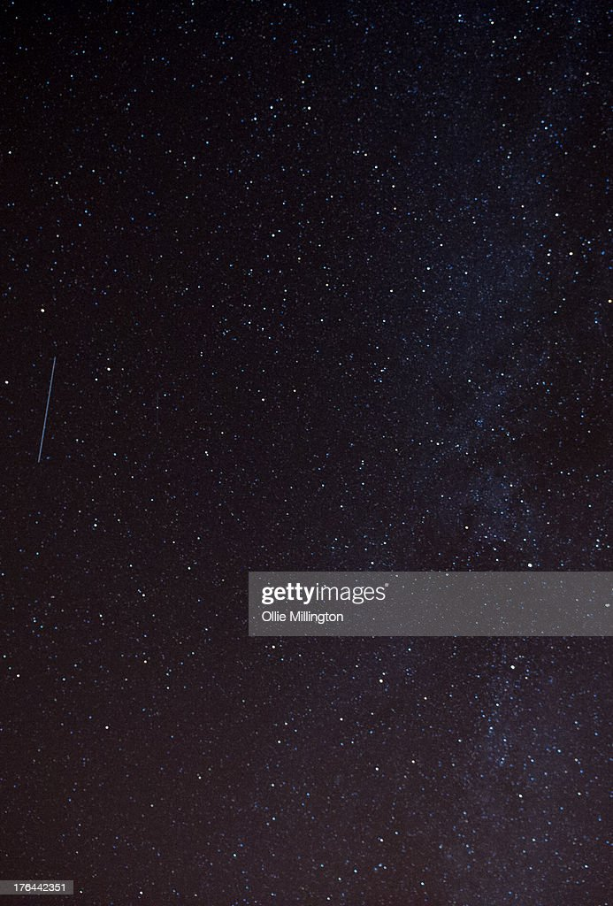 A Perseid meteor streaks across the night sky during the peak of the annual Perseid meteor shower on August 12, 2013 in London, England. The annual display, known as the Perseid shower because the meteors appear to radiate from the constellation Perseus in the northeastern sky, is a result of Earth's orbit passing through debris from the comet Swift-Tuttle.