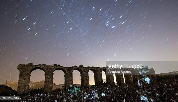 Perseid meteor streaks across the sky above historical aqueduct at ancient city of Aspendos in Serik district of Antalya Turkey on December 14 2015