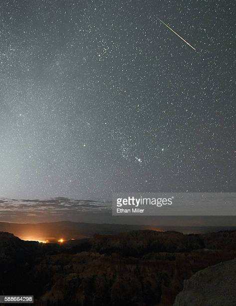 Perseid meteor streaks across the sky above Inspiration Point early on August 12 2016 in Bryce Canyon National Park Utah The annual display known as...