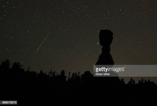 Perseid meteor streaks across the sky left of the hoodoo named Thor's Hammer early on August 13 2016 in Bryce Canyon National Park Utah The annual...