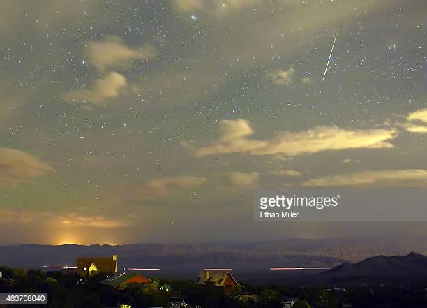 Perseid meteor streaks across the sky over the community of Cold Creek on August 12 2015 in the Spring Mountains National Recreation Area Nevada The...
