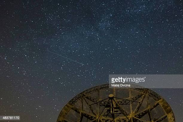 Perseid meteor streaks across the sky over the radar near the Astronomical Institute of the Academy of Science of the Czech Republic on August 12...