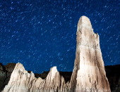 Perseid meteors streak across the sky on August 12 2013 in Cathedral Gorge State Park Nevada The annual display known as the Perseid shower because...