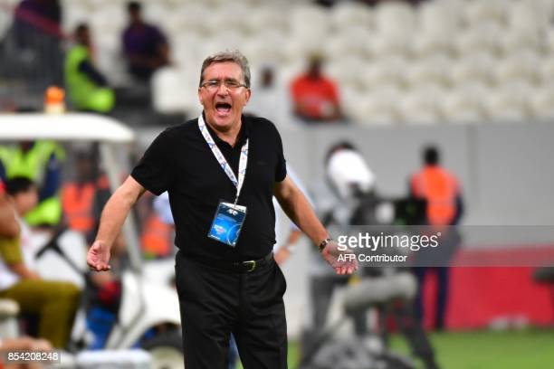 Persepolis' coach Branko Ivankovic gestures during the first leg of their AFC Champions League semifinal football match at the Mohammed Bin Zayed...