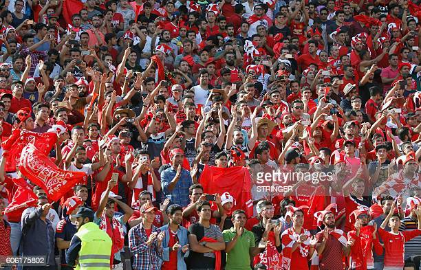 Persepolis fans cheer during their Persian Gulf Pro League derby football match between Persepolis FC and Esteghlal FC at the Azadi stadium in Tehran...