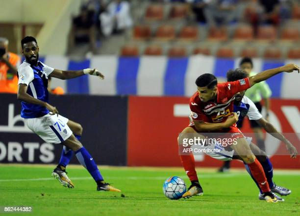 Persepolis' forward Ali Alipour controls the ball during the Asian Champions League semifinal football match between Persepolis and AlHilal at the...