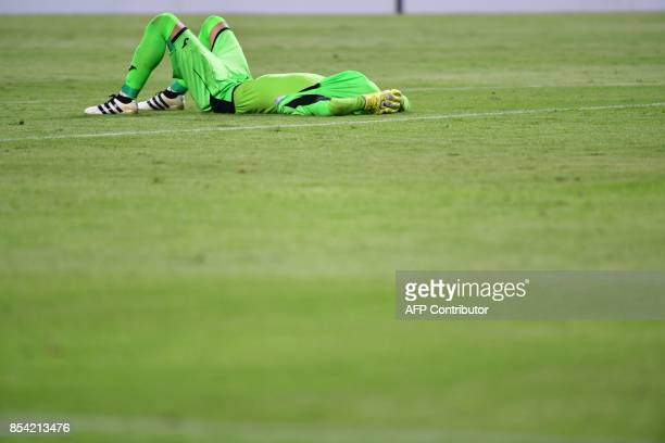 Persepolis' goalkeeper Alireza Beiranvand reacts at the end of the first leg of their AFC Champions League semifinal football match at the Mohammed...