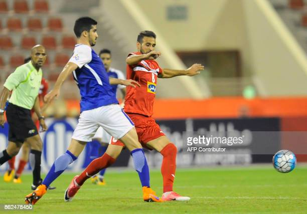 Persepolis' midfielder Ahmad Noorallah vies for the ball with AlHilal's defender Abdullah AlHafith during the Asian Champions League semifinal...