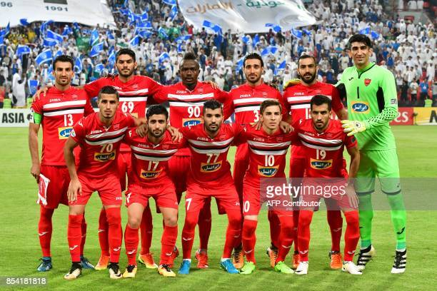 Persepolis' starting eleven pose for a group picture ahead the first leg of their AFC Champions League semifinal football match against Al Hilal at...