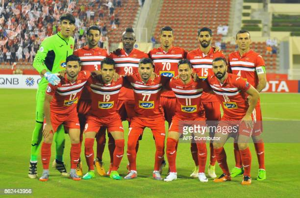 Persepolis' starting eleven pose for a group shot ahead of the Asian Champions League semifinal football match between Persepolis and AlHilal at the...