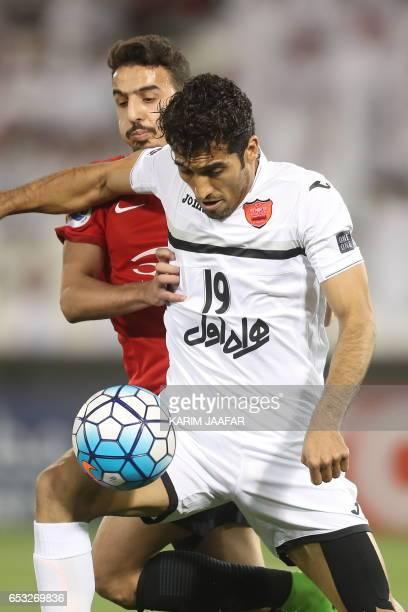 Persepolis' Vahid Amiri fights for the ball during the Asian Champions League football match between Qatar's AlRayyan and Iran's Persepolis at Jassim...