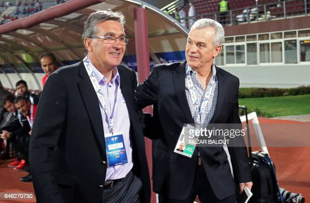 Persepolis's head coach Branko Ivankovic chats with AlWahda's head coach Javier Aguirre during the AFC Champions League qualifying football match...