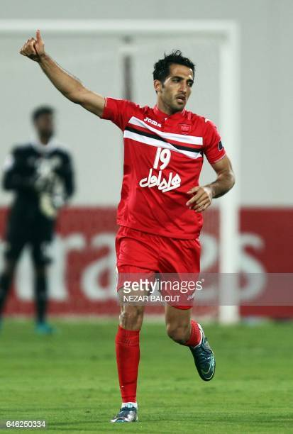 Persepolis's Vahid Amiri celebrates after scoring a goal during the AFC Champions League qualifying football match between UAE's AlWahda and Iran's...