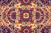 Persian Carpet. Closeup of national popular antique oriental backdrop, beautiful artistic, texture. Abstract repeating design of red blue flower on yellow color style background wallpaper texture.