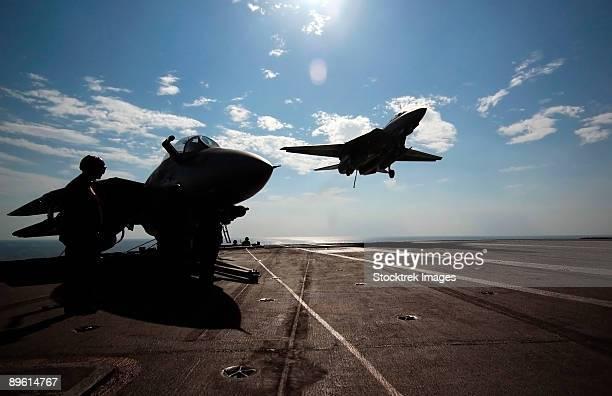Persian Gulf, January 6, 2005 - An F-14D Tomcat prepares to make an arrested landing on the flight deck aboard the Nimitz-class aircraft carrier USS Theodore Roosevelt (CVN-71).