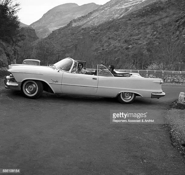 Persian princess Soraya Esfandiary Baktiary and Italian prince Raimondo Orsini driving a car Italy 1956