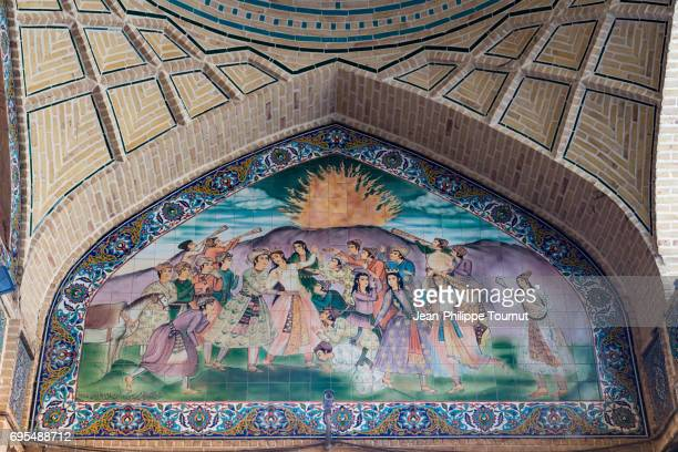 Persian scene painted on tiles in an alley, Isfahan, Iran