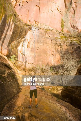 Persian woman hiking near cliff : Stock Photo