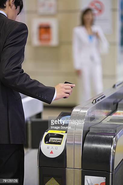 Person at ticket barrier