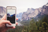 Person at Yosemite Taking Picture with Phone