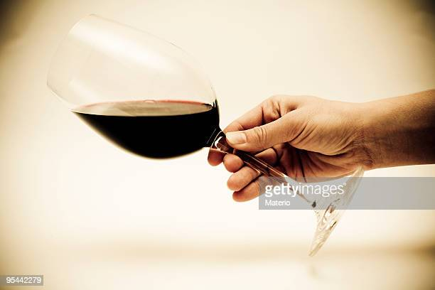 Person being careless with a glass of red wine
