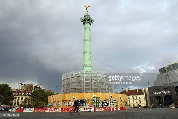 A person bikes next to the Bastille column under renovation on September 19 2016 Renovation will last until 2018 and will allow visitor to visit the...