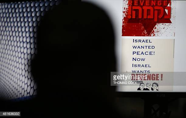 A person browses an Israeli social network website inciting attacks against Palestinians on July 3 2014 in Jerusalem as cyberactivists joined...