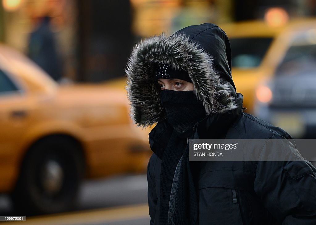 A person bundled against the cold in Manhattan January 24, 2013 in New York as cold continues to grip the northeast. From the midwest to the East coast freezing temperatures have be responsible for several deaths. AFP PHOTO/Stan HONDA